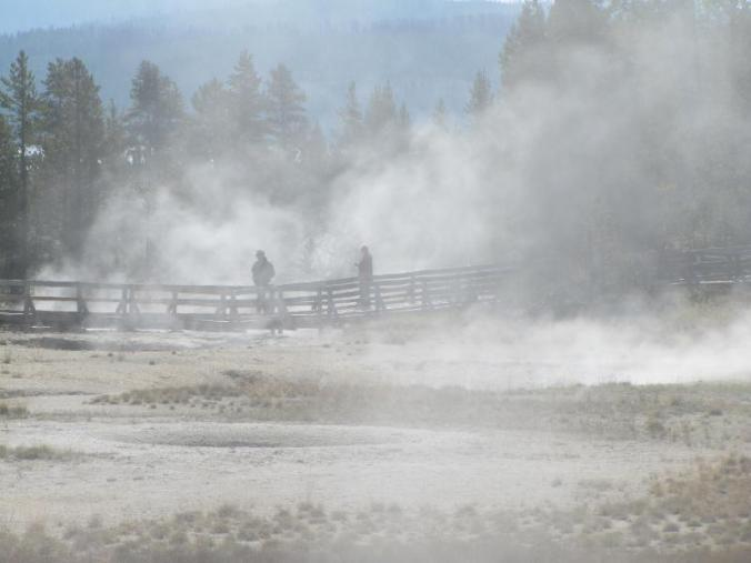 The geysers cover the walkways with steam