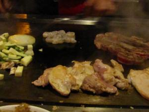 Chicken, steak, shrimp and veggies on the grill at the Kyoto