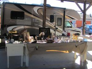 Our RV parked adjacent to our vendor booth at Stokes Flea Market.