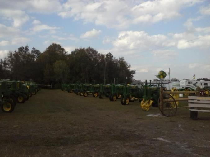 An impressive line up of antique John Deere tractors