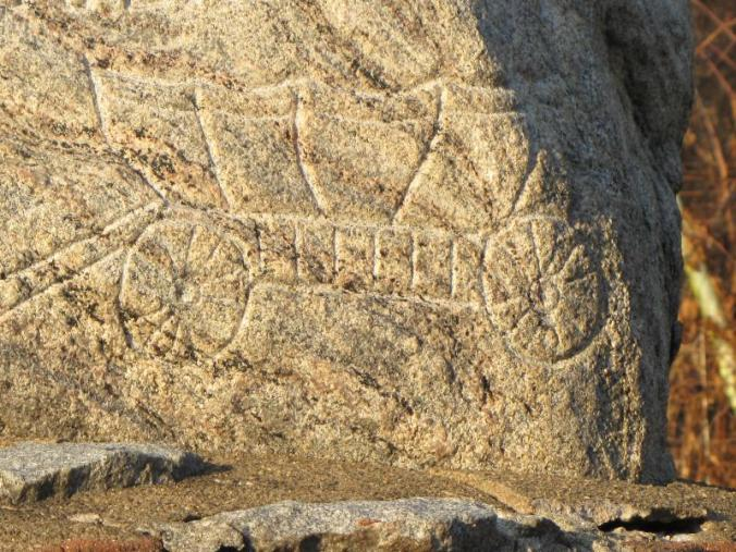 Conestoga wagon etched into the granite