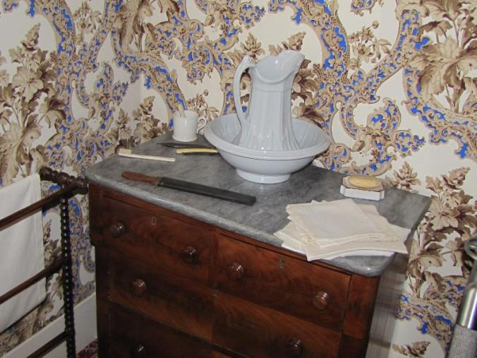 Lincoln's dresser with wash basin and pitcher and shaving gear.