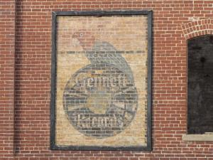 The origianl Genett Parrot logo still seen on the wall of the remaining brick building