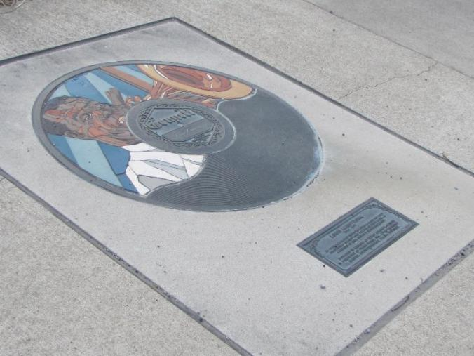 Louis Armstrong honored on the sidewalk next to the remains of the old recording studio. There are many musicians so honored.