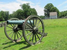 Artillery cannon with the plantation buildings in the background