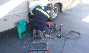 Cummings Crosspoint technician checking our Onan generator