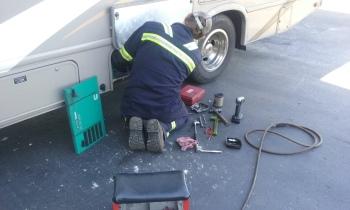 Cummings Crosspoint technician checking our Onan generator
