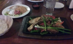 Sizzling beef and chicken fajitas at El Charro Café