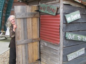 Sher in the two hole outhouse