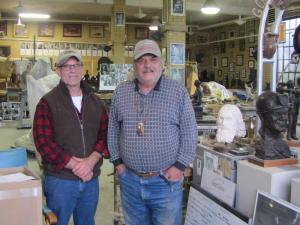 Alan Cottrill, left, with Maj inside Alan's Studio and Gallery