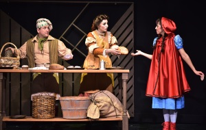 Little Red Ridinghood (Jaddy Ciucci), right, asks for a loaf of bread from the Baker (Don Farrell), left, and his wife (Meaghan Sands), center, in Beef & Boards Dinner Theatre's production of Stephen Sondheim's Into the Woods. Photo courtesy B&B media