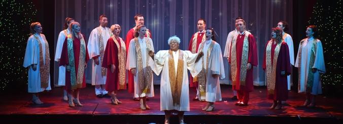 "Kendra Lynn Lucas center stage singing ""O Holy Night"""